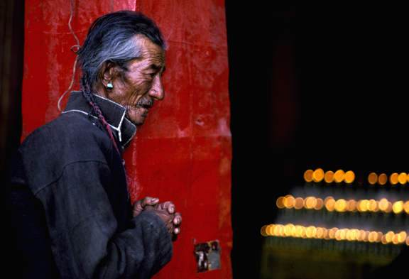 Photo of a Pilgrim at the Jokhang Temple in Lhasa, Tibet