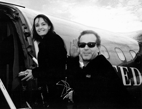 Photo of Becky and Jeffrey Aaronson getting on a plane