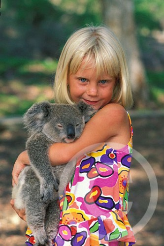 Photo of a girl in Australia holding a koala