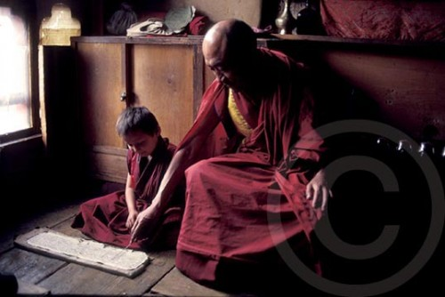 Photo of a monk teaching a child in Bhutan