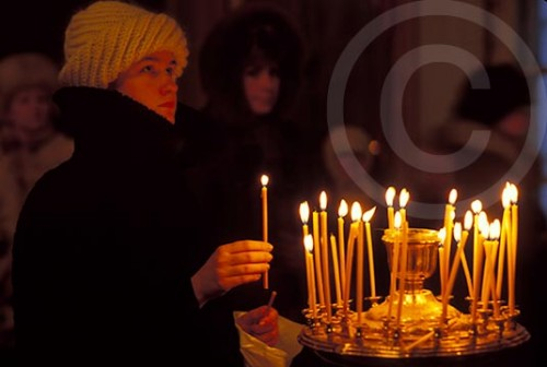 Russian woman praying at a Russian Orthodox chuch in Moscow, Russia