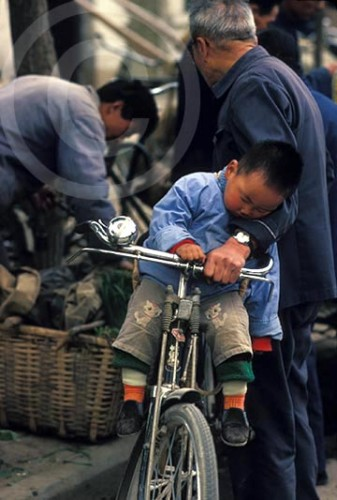 Photo of a grandfather and grandson at a market in Xian, China