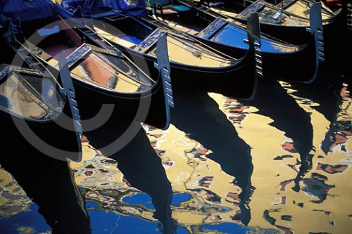 Photo of gondolas reflected in the Grand Canal of Venice, Italy