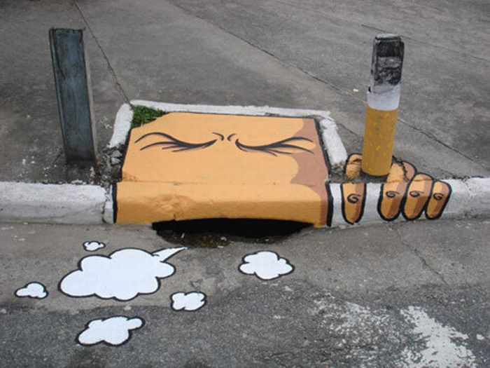 Photo of street art cigarette sewer