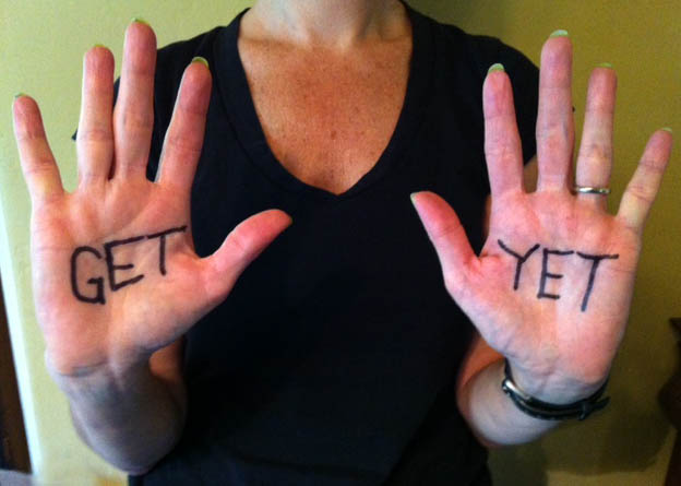 Photo of hands with the words GET and YET