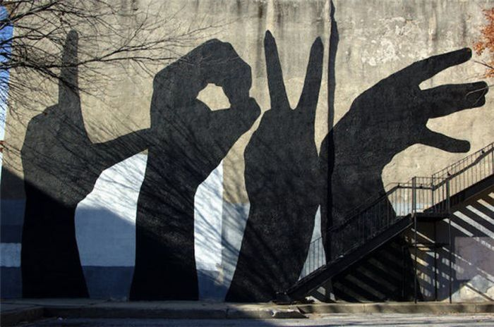 Photo of street art love shadow