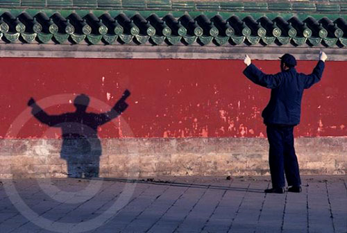 Photo of a man doing tai chi in Rutan Park in Beijing, China