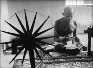 Photo of Gandhi at his spinning wheel