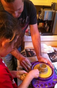 Father and daughter doing pottery