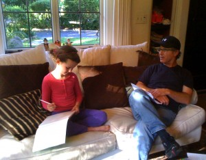 Photo of a father and daughter doing homework