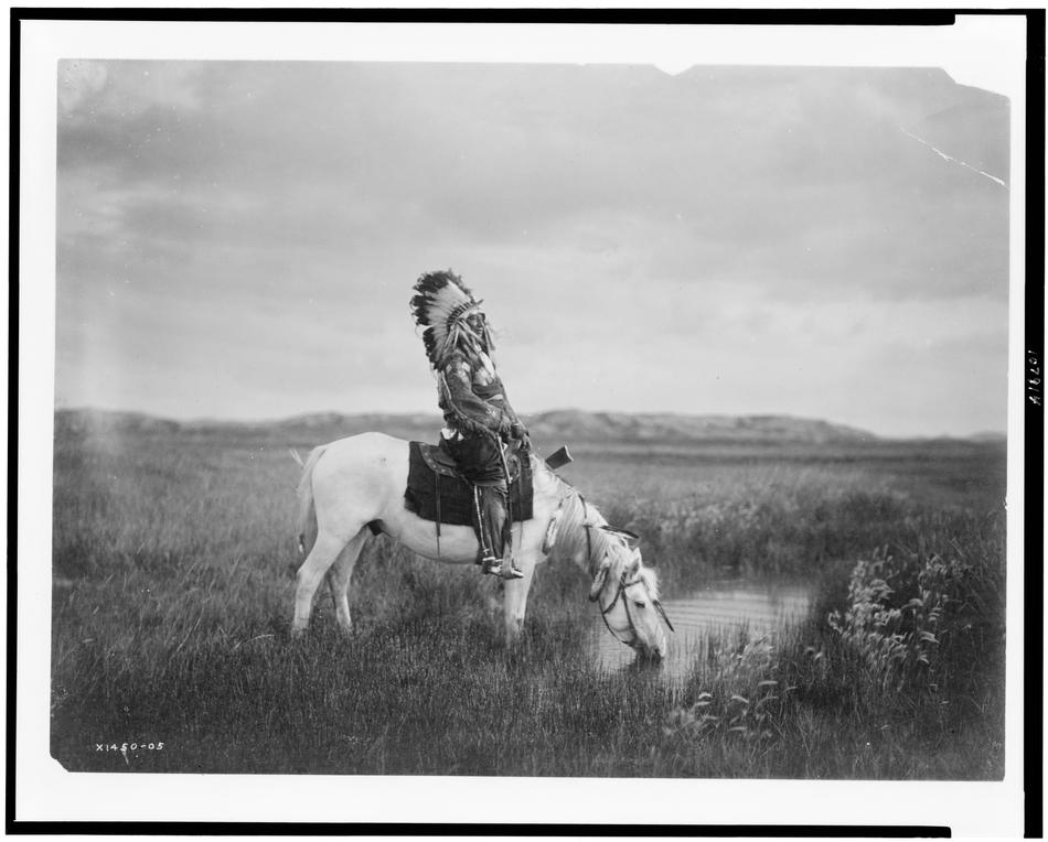 Edward Curtis photo of Oglala Man in the Badlands