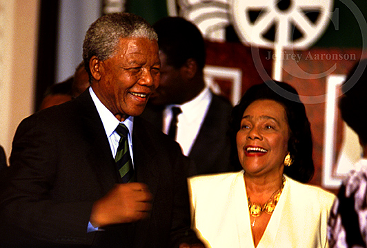 Photo of Nelson Mandela and Coretta Scott King celebrating Mandela's win in 1994