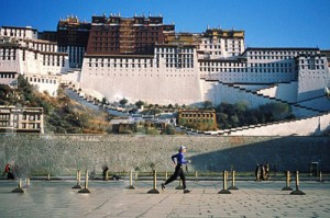 Becky Green Aaronson running in front of the Potala Palace in Lhasa, Tibet
