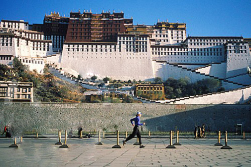 Becky Green Aaronson running at Potala Palace in Lhasa, Tibet